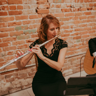 Laura Strickland plays flute at wedding ceremony